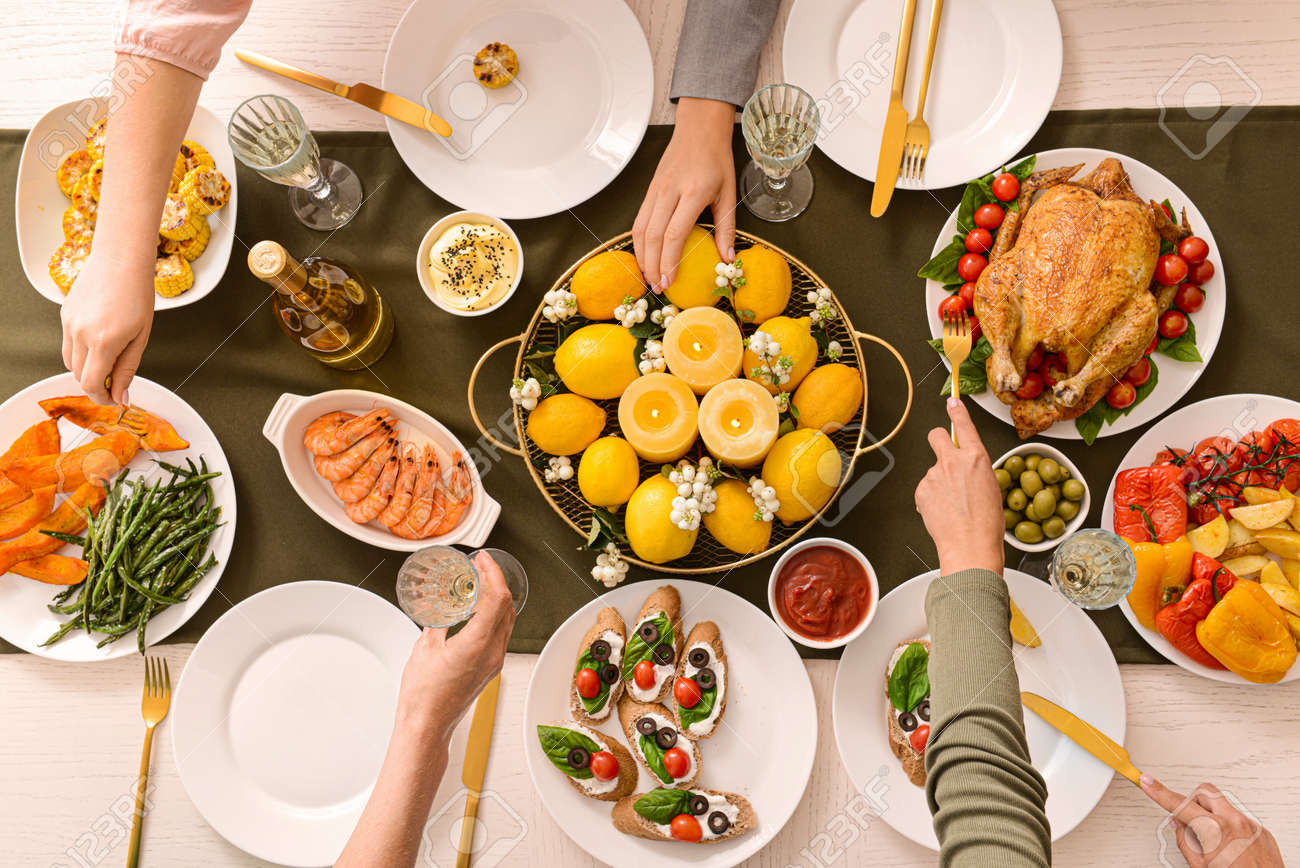 Friends having dinner at table, top view - 165530838