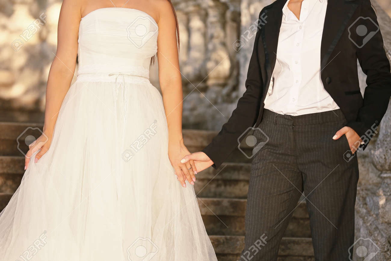 Beautiful couple on their wedding day outdoors - 165721670