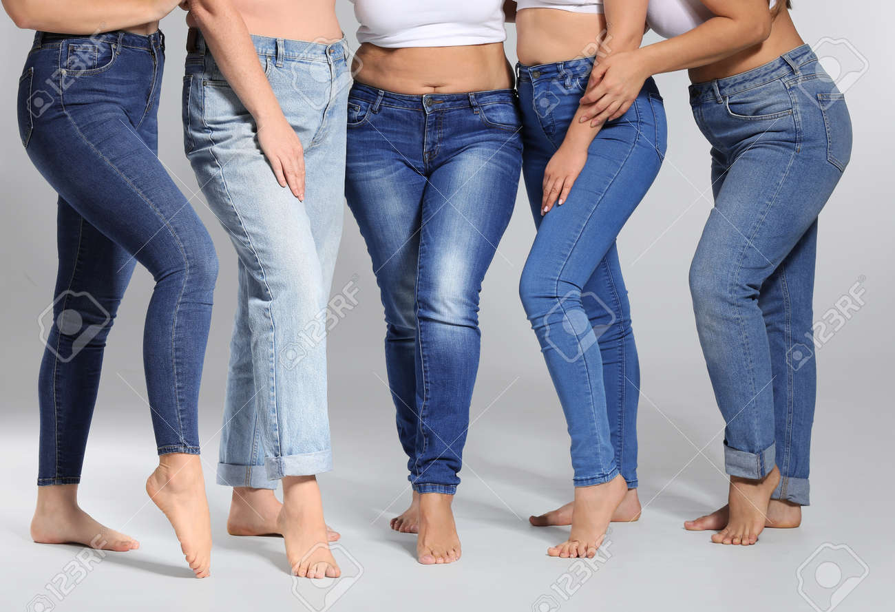Group of body positive women on gray background - 165530825