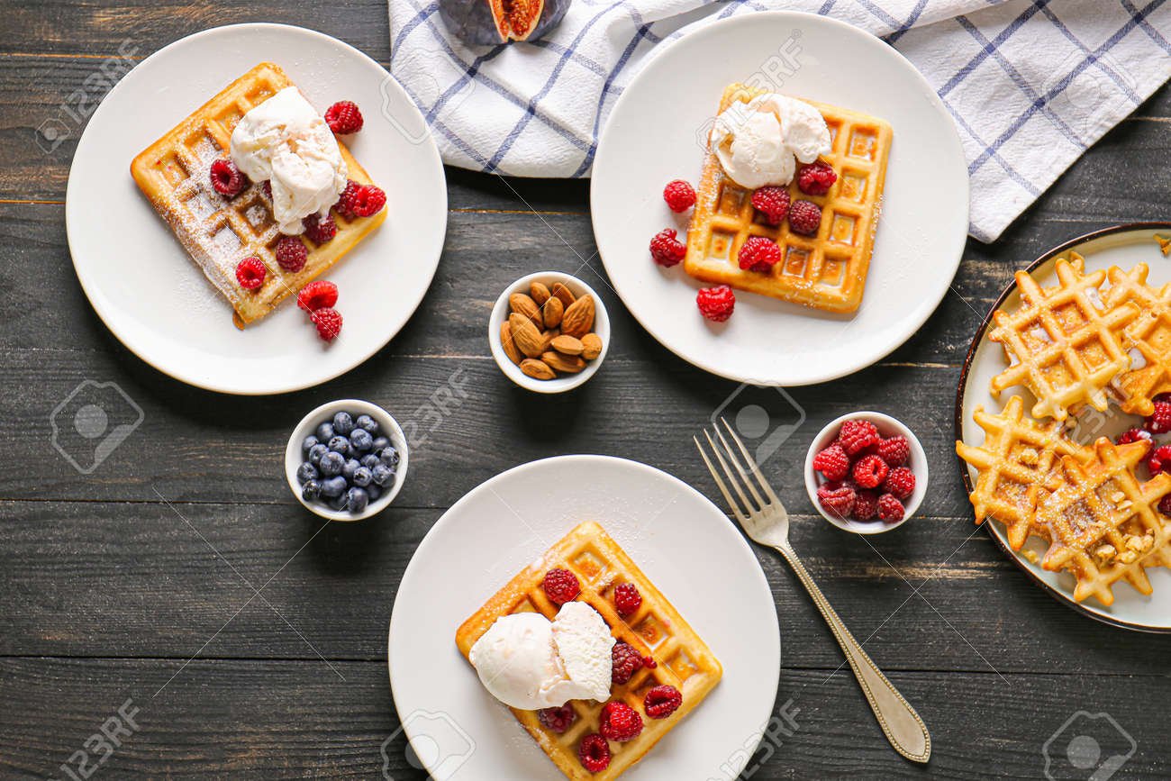 Composition with tasty waffles on table - 165515172