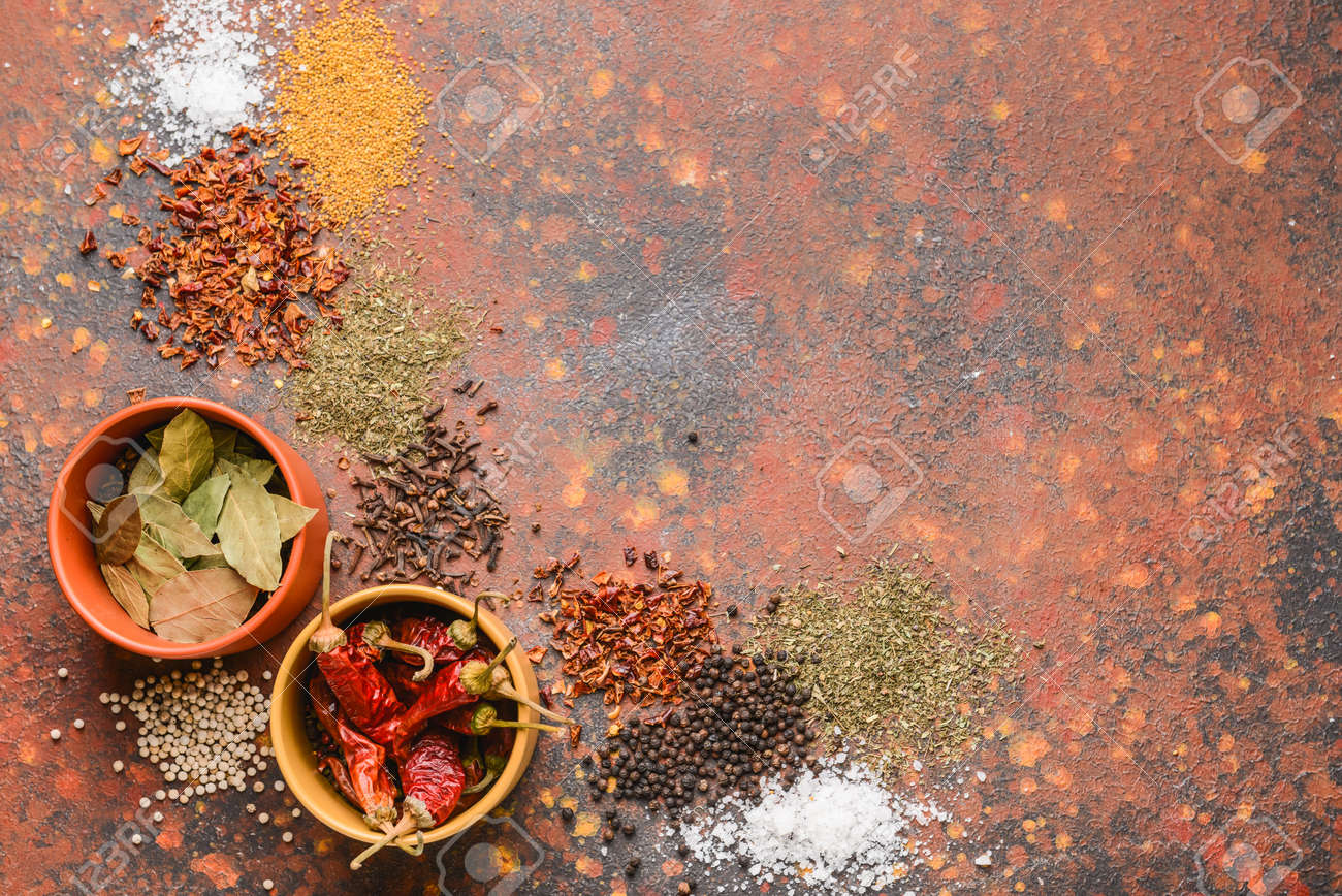 Bowls with different spices on color background - 165515629