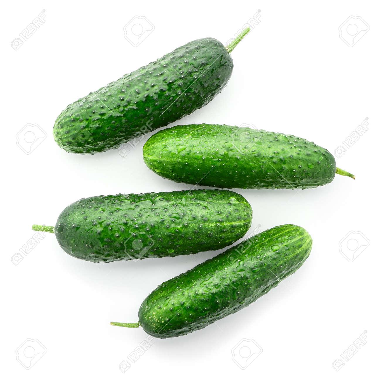 Fresh green cucumbers on white background - 165955622