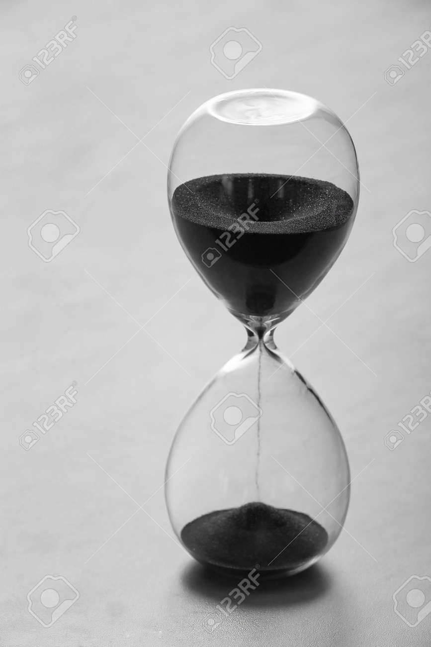 Crystal hourglass on light background - 165717202