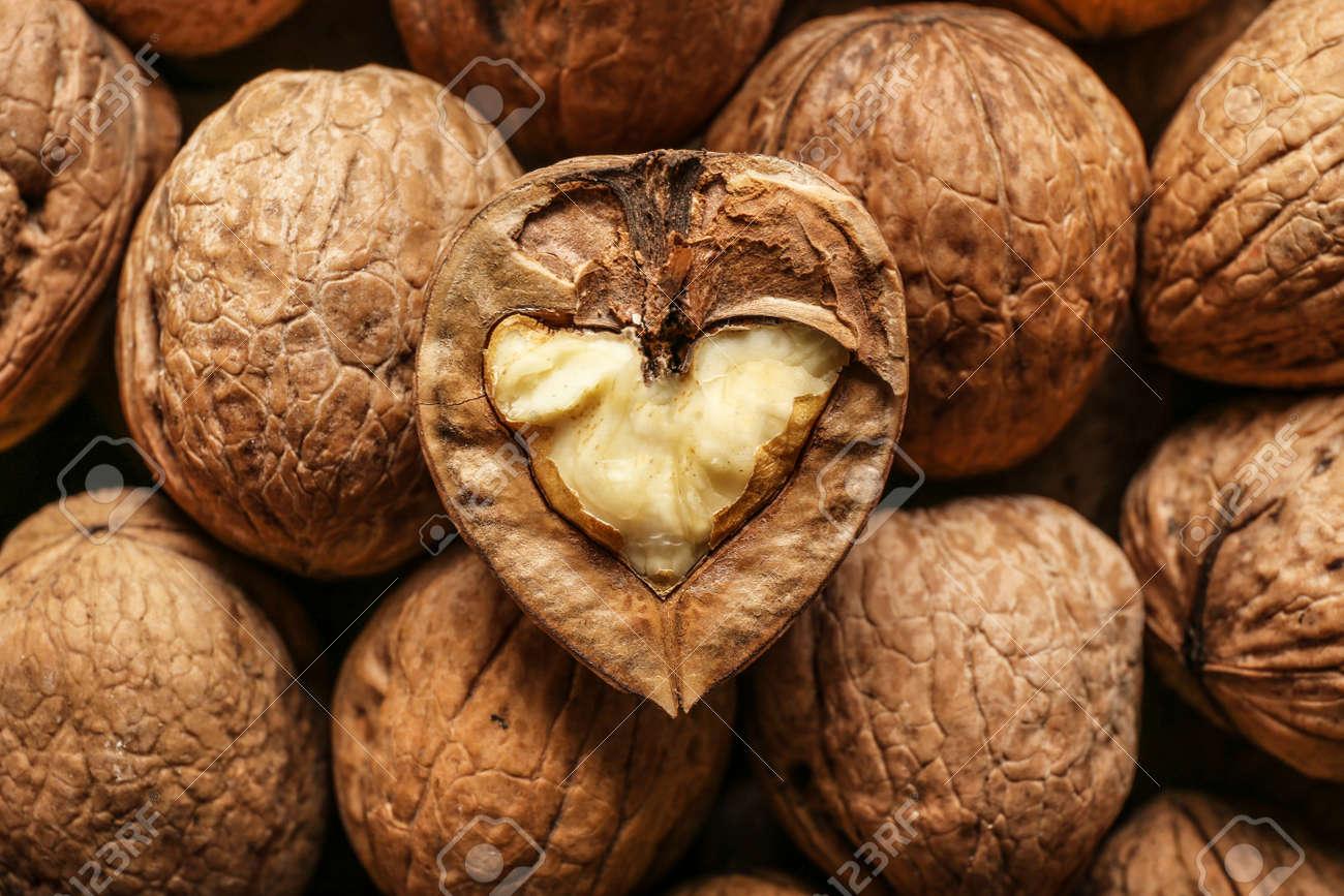 Many tasty walnuts as background - 165719783