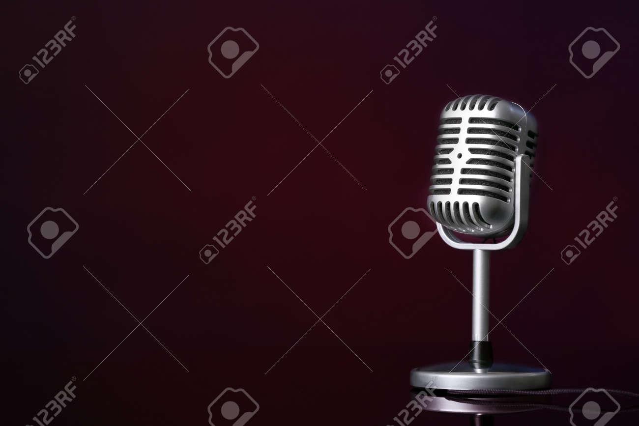 Retro microphone on dark color background - 165725542
