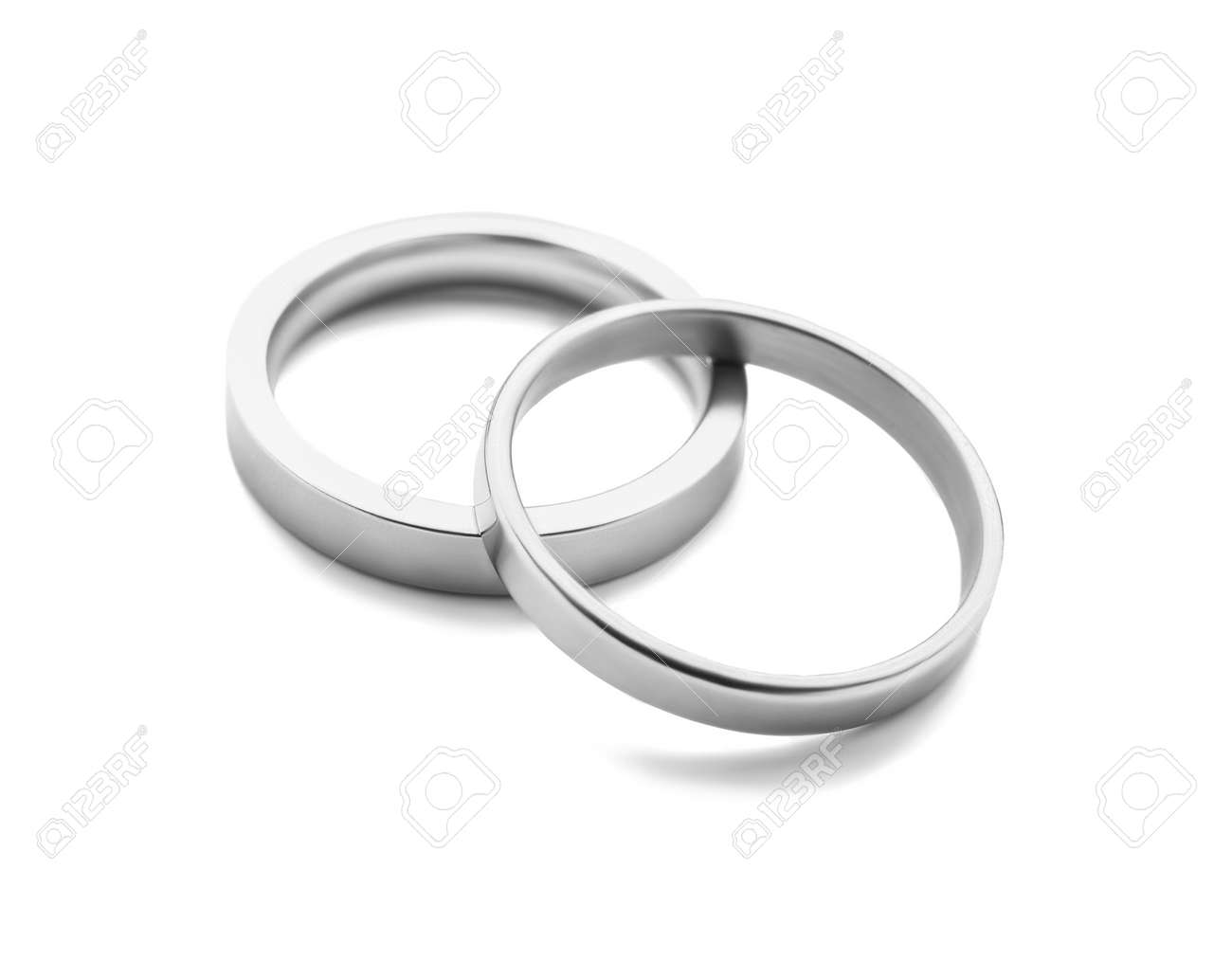 Pair of wedding rings on white background - 165834237