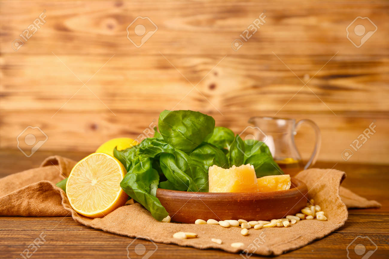 Ingredients for pesto sauce on wooden background - 165932335