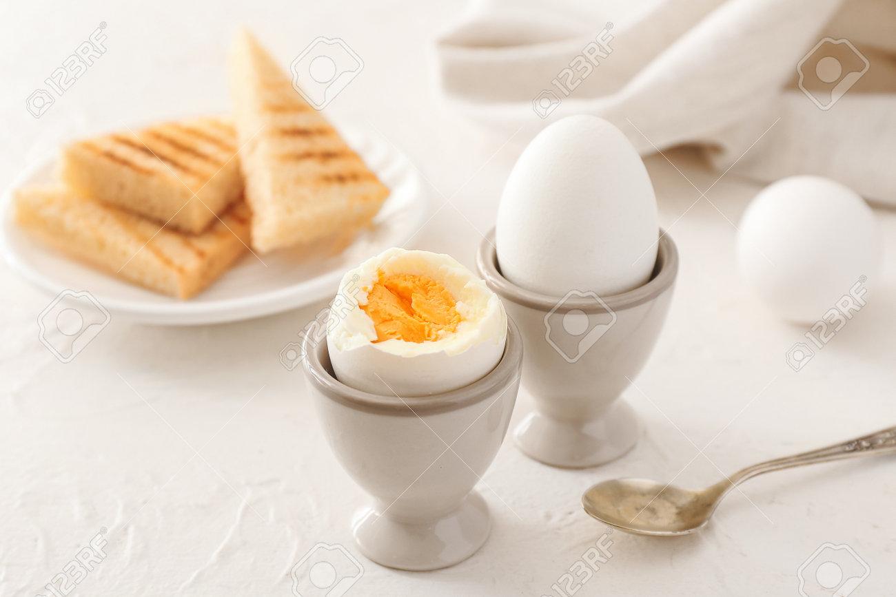 Tasty boiled eggs on table - 165988068