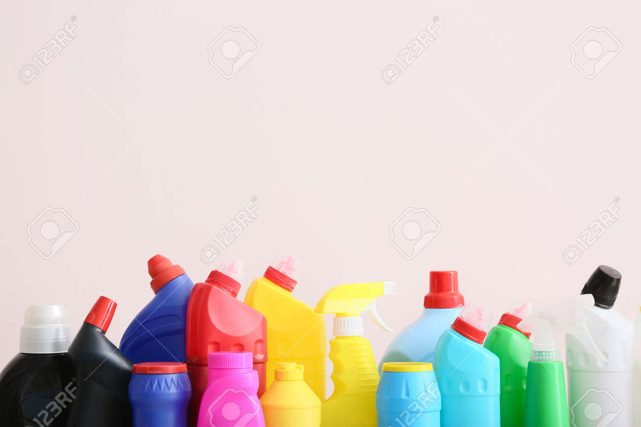 Set of cleaning supplies on light background - 165995022