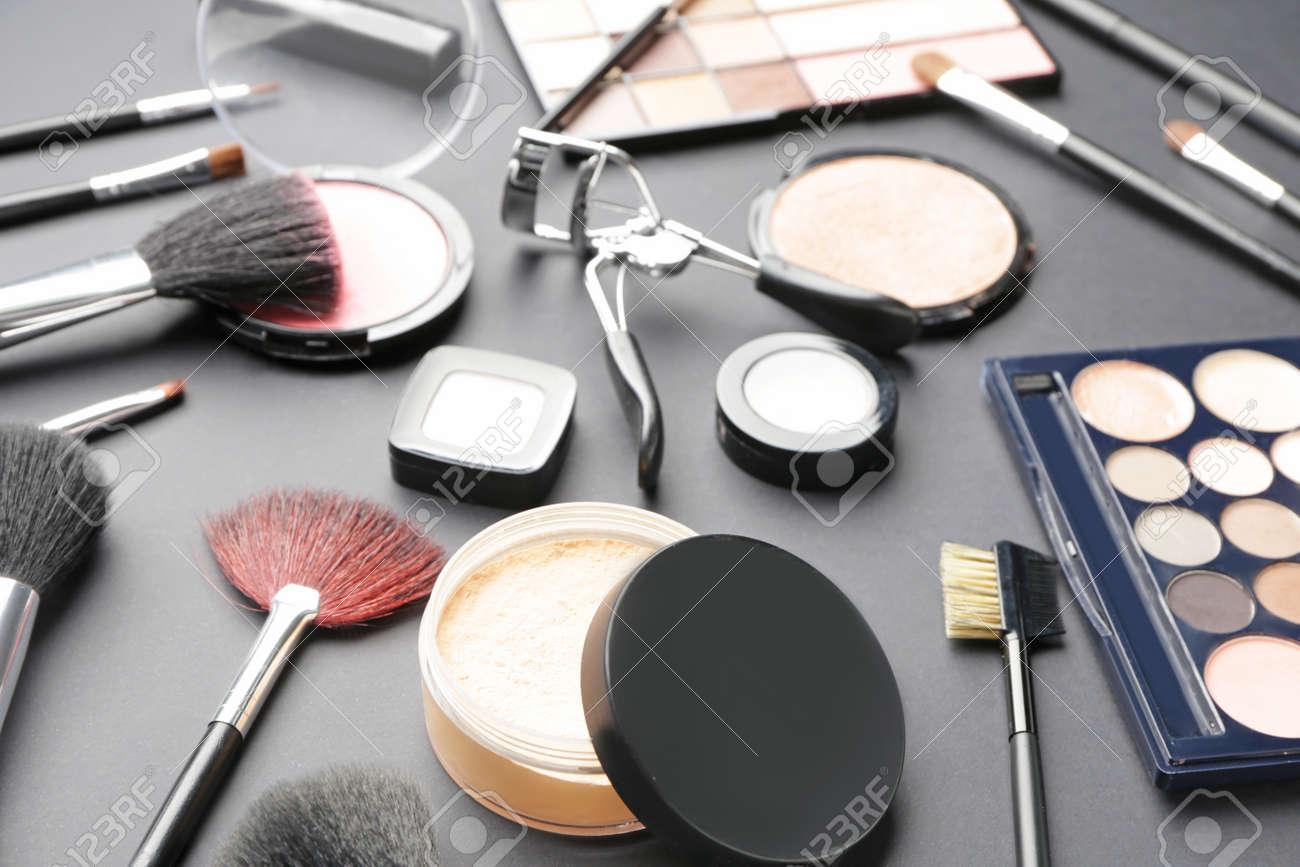 Set of decorative cosmetics on dark background - 166353864
