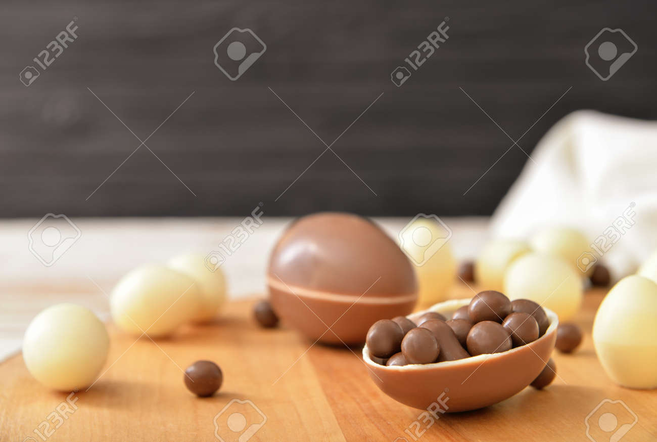 Chocolate eggs and candies on table - 166223375