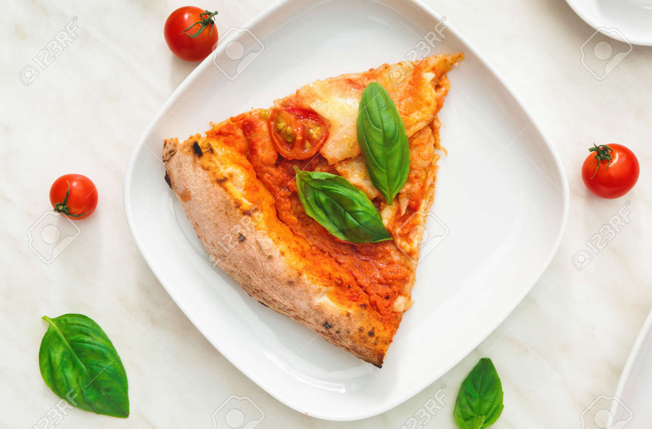 Plate with slice of delicious pizza Margherita on table - 166268489