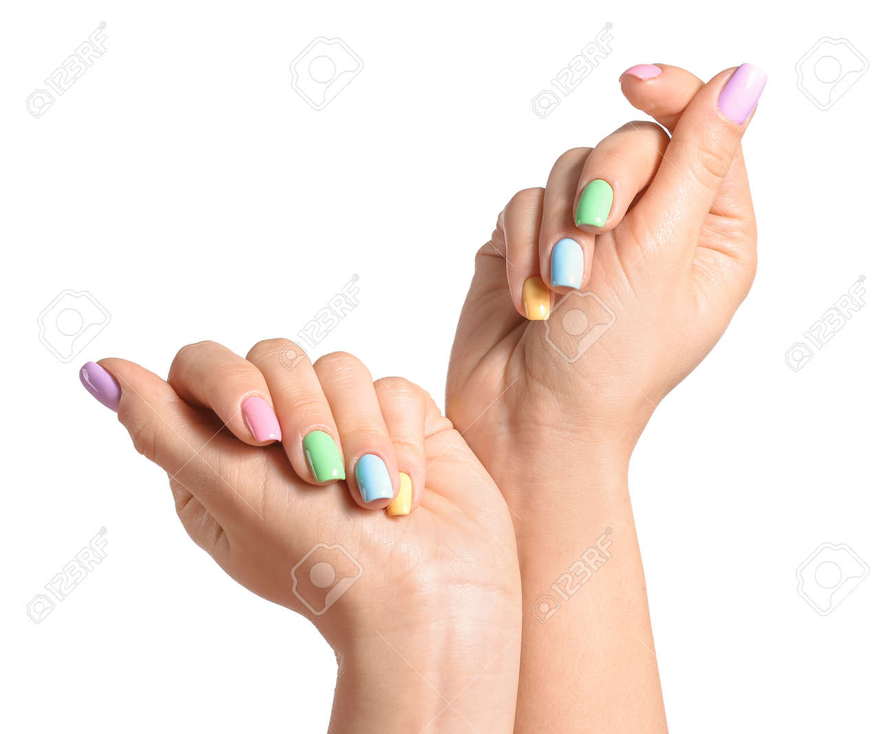 Hands of young woman with beautiful manicure on white background - 166268515