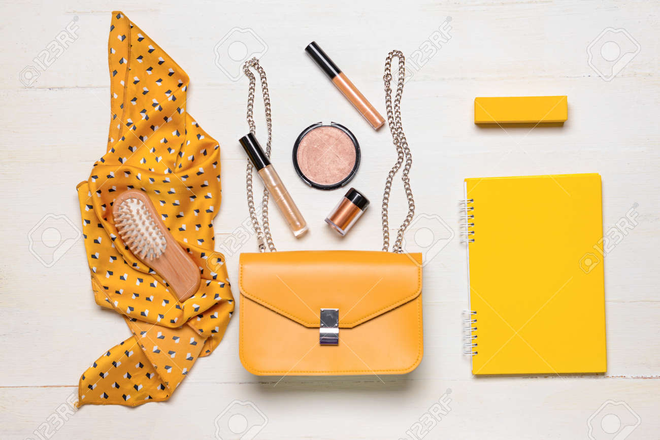 Stylish bag with female accessories and notebook on white wooden background - 166346813