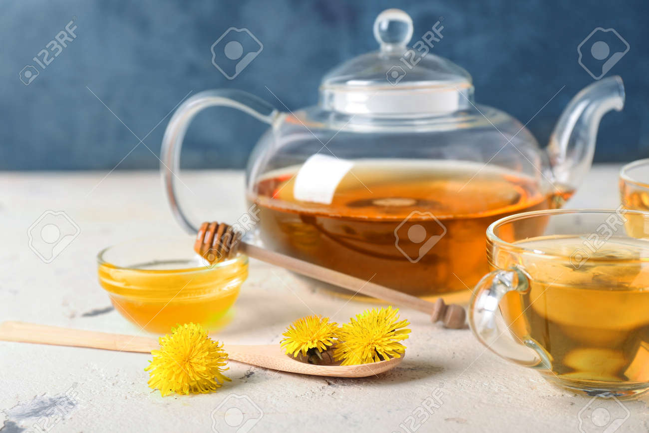Healthy dandelion tea with honey on table - 166466502