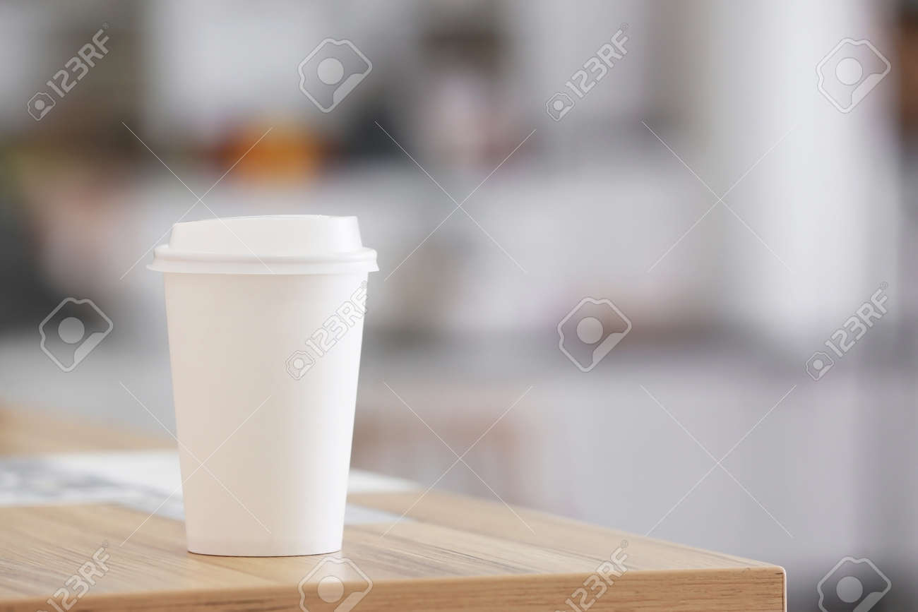 Takeaway cup for drink on table - 166500370