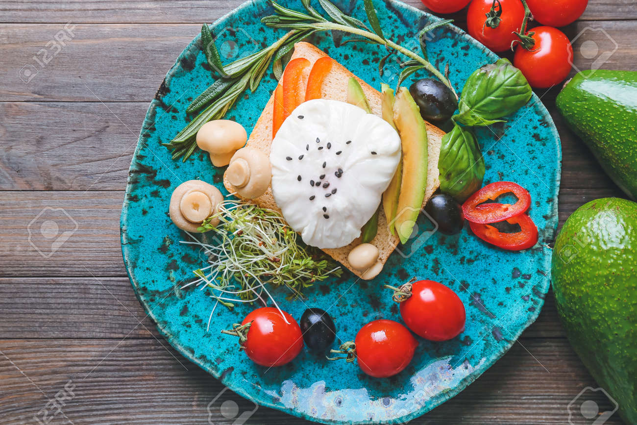 Plate with tasty sandwich with egg on table - 166677854