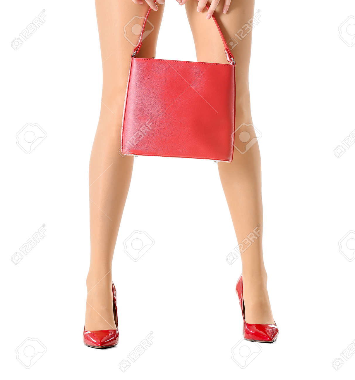 Beautiful young woman in tights and with bag on white background - 166676286
