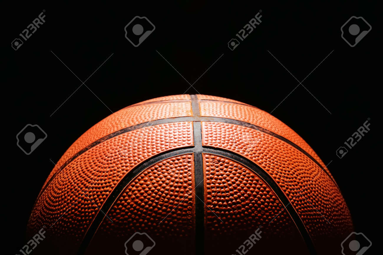 Ball for playing basketball on dark background, closeup - 169049722