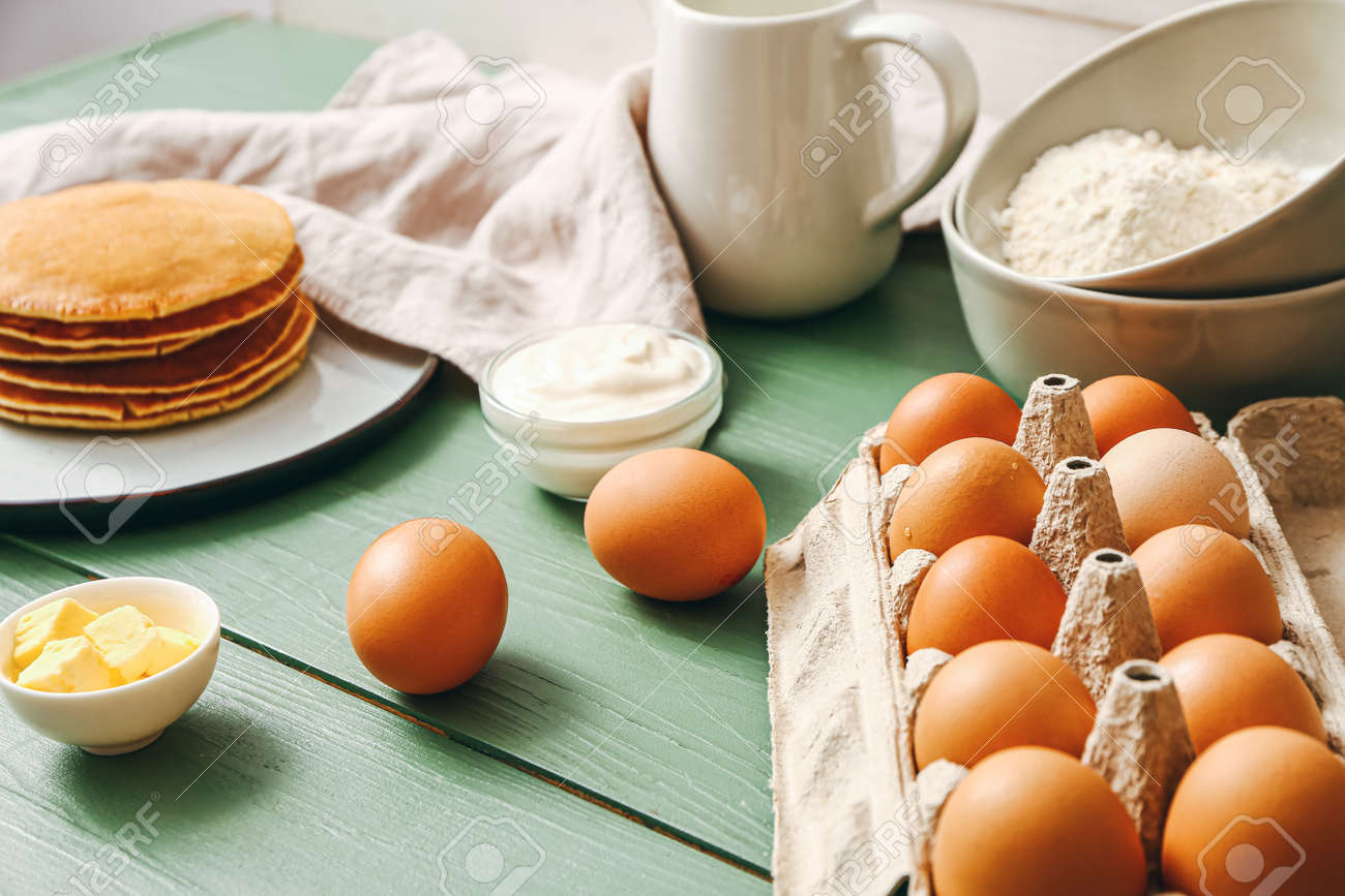 Ingredients for pancakes on table - 169080727