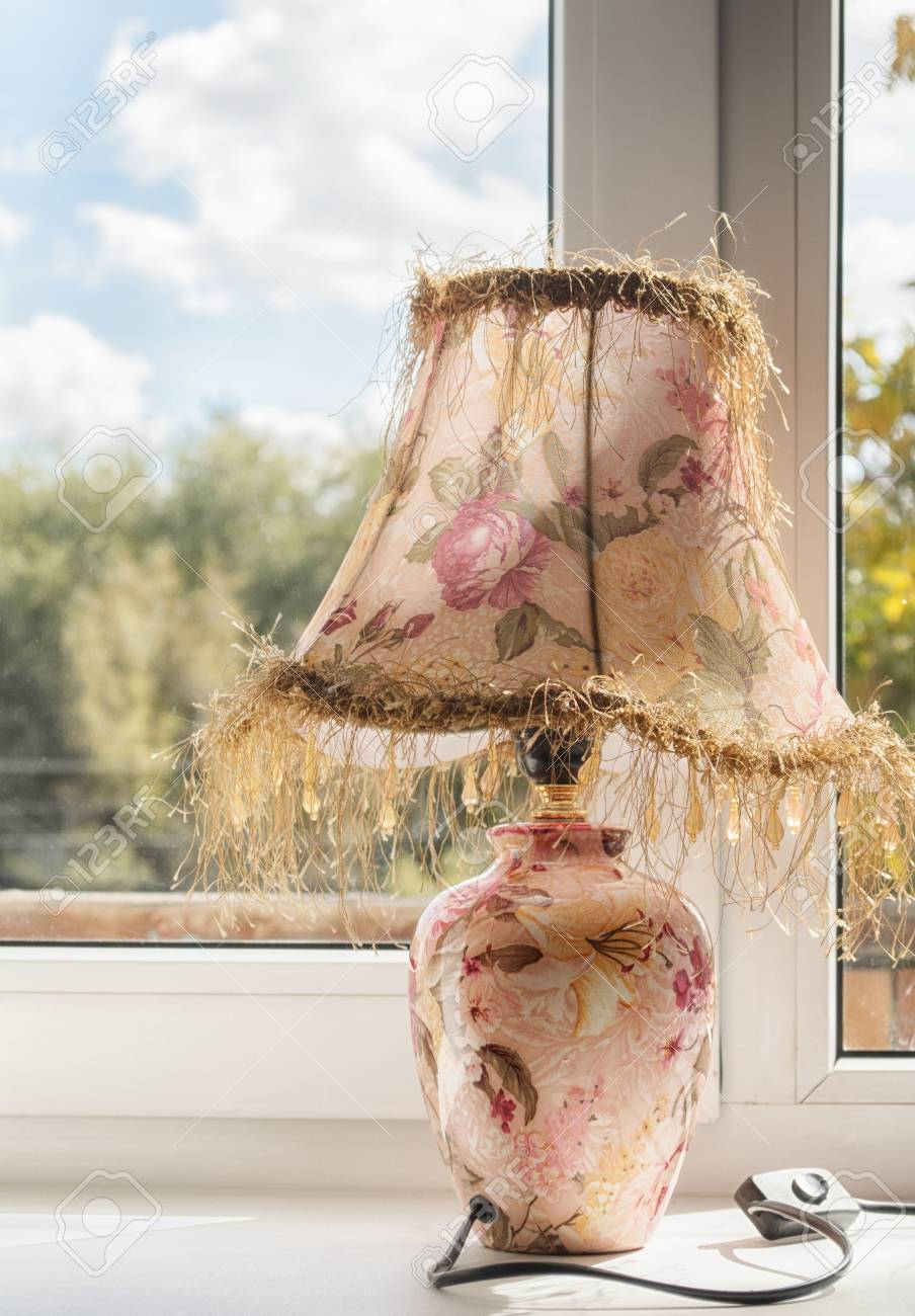 Lamp with the lamp shade at a window in the afternoon outside lamp with the lamp shade at a window in the afternoon outside the window in aloadofball Image collections