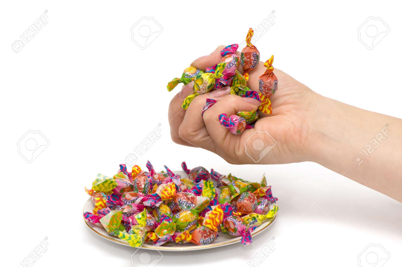 The woman holds in hands of a sweet. Stock Photo - 2201895