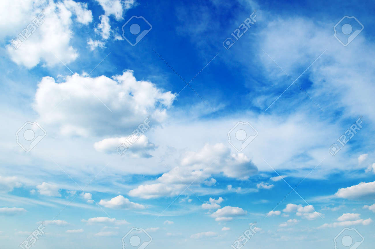 white fluffy clouds in the blue sky stock photo picture and royalty