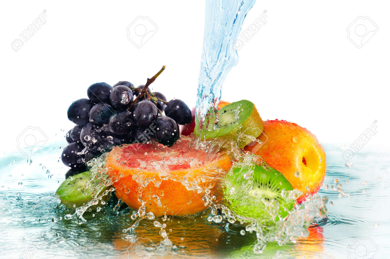 fruit in a spray of water isolated on a white background - 12740121