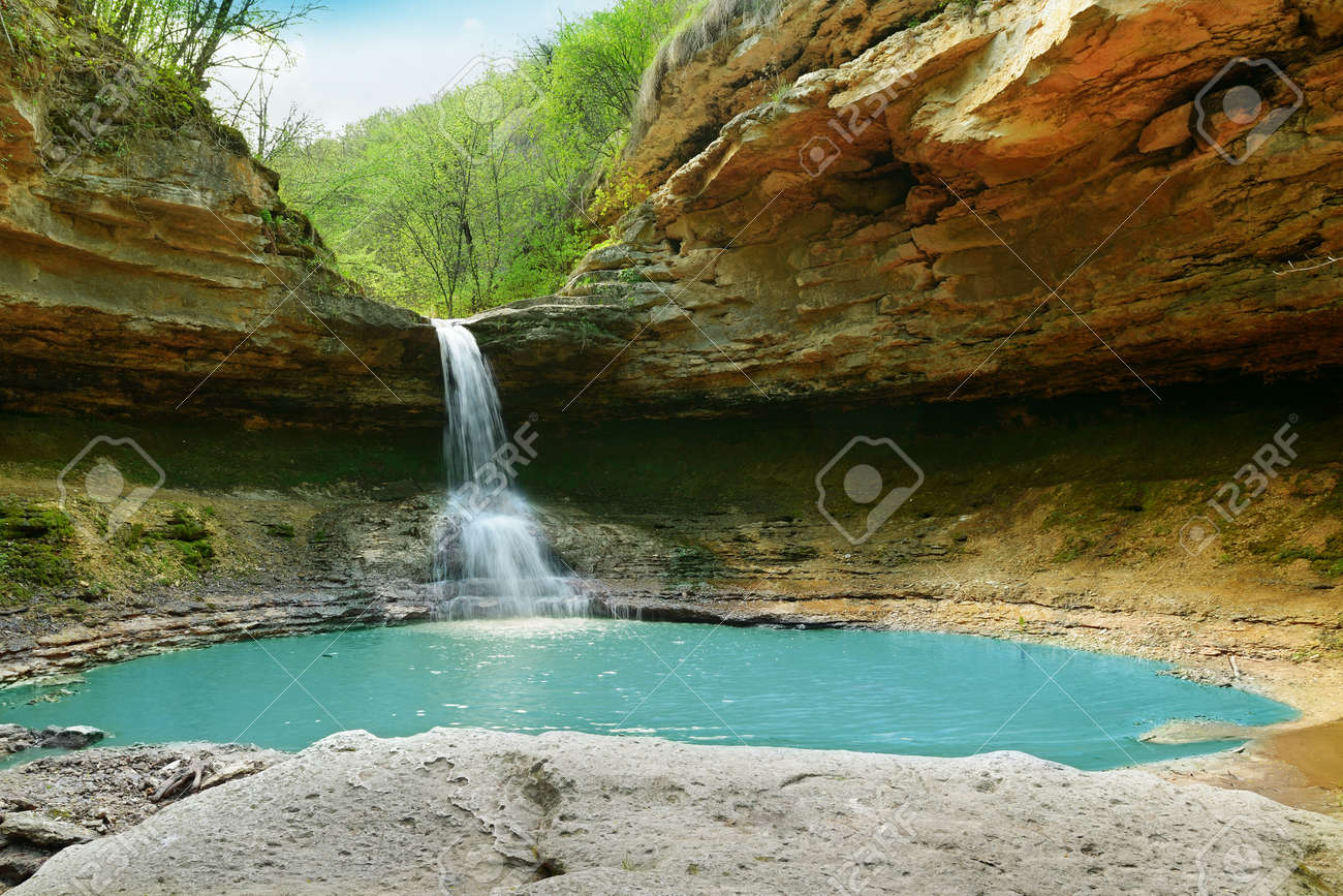 lake and waterfall in the forest - 13522965