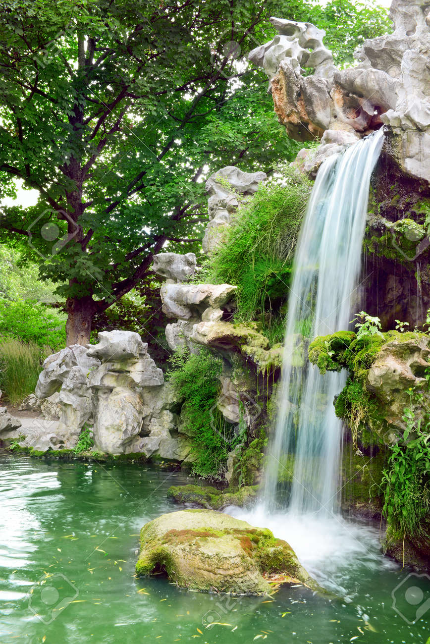 Large waterfall in the park - 17595296