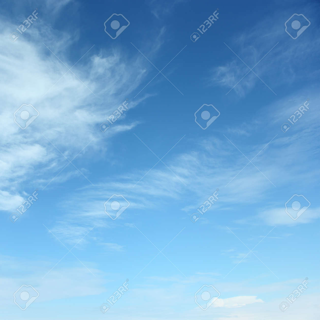 white fluffy clouds in the blue sky - 32444303