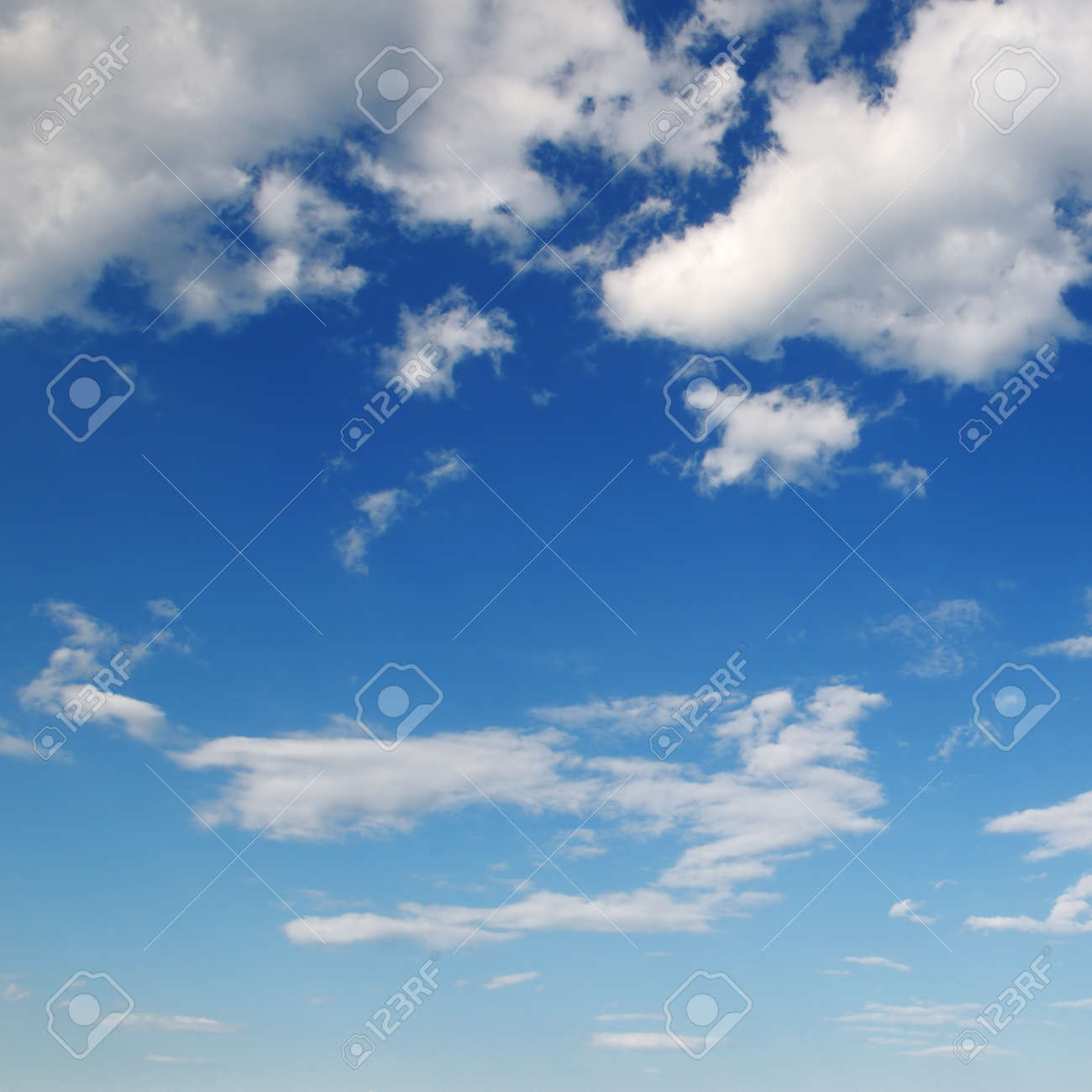 white fluffy clouds in the blue sky - 45051744