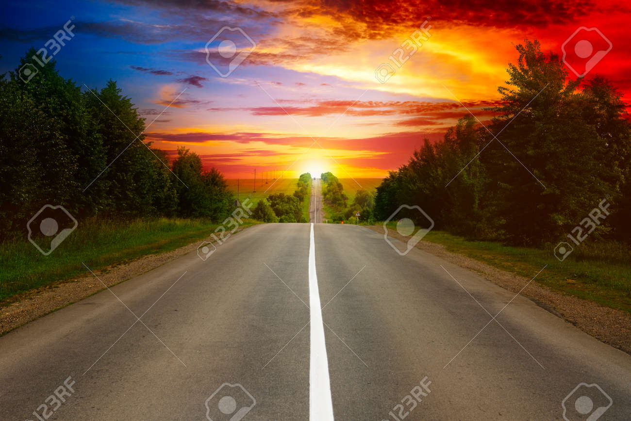 road between trees and beautiful sunset - 57243464