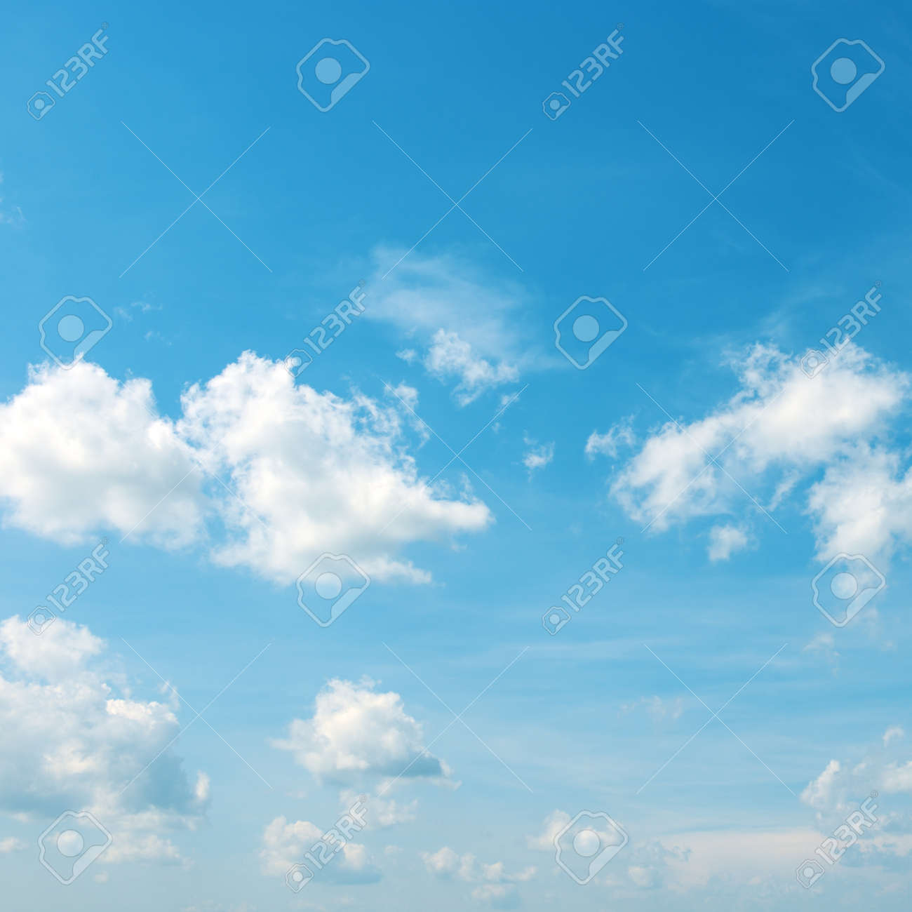 Heavenly landscape - white clouds in bright blue sky. - 123610783