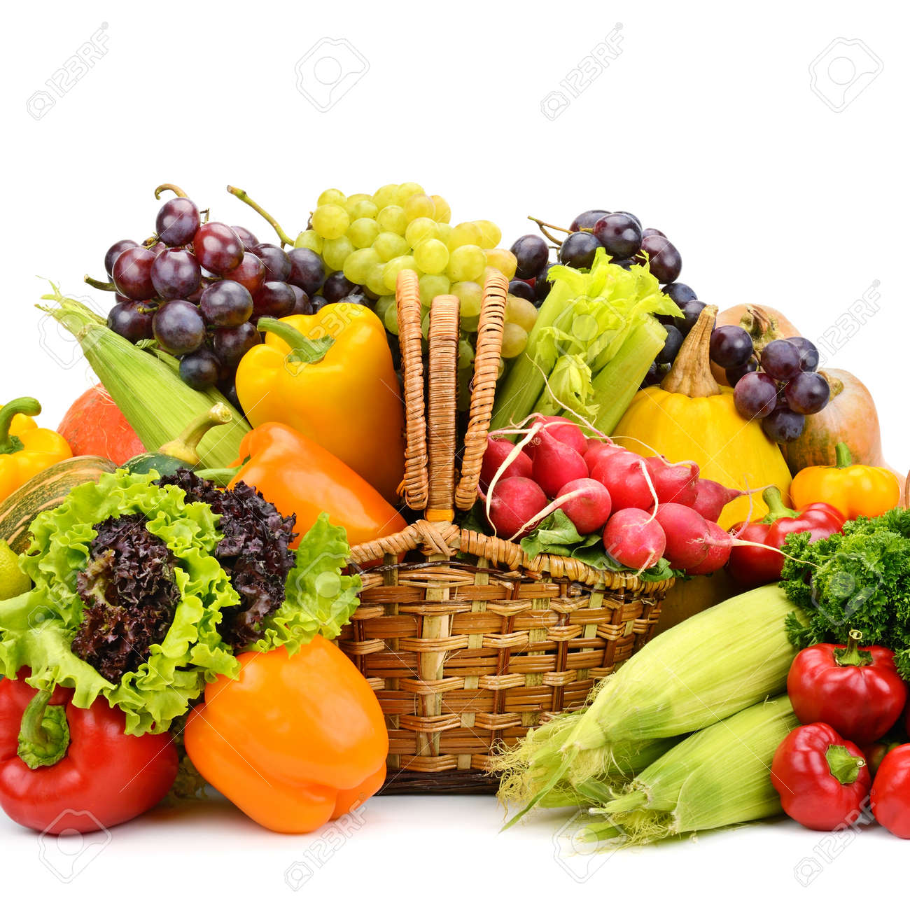 Healthy vegetables and fruits in willow basket isolated on white - 129541202