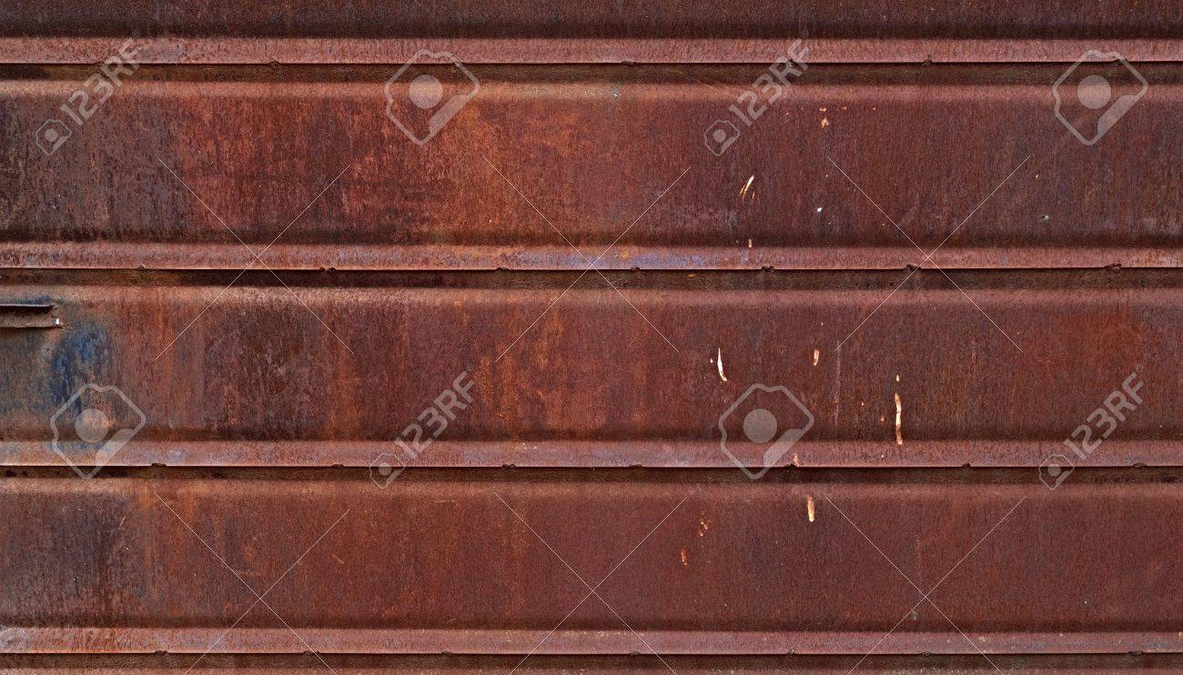 Grunge rusted metal wall made of overlapping plates. May be used as background or texture Stock Photo - 15768740