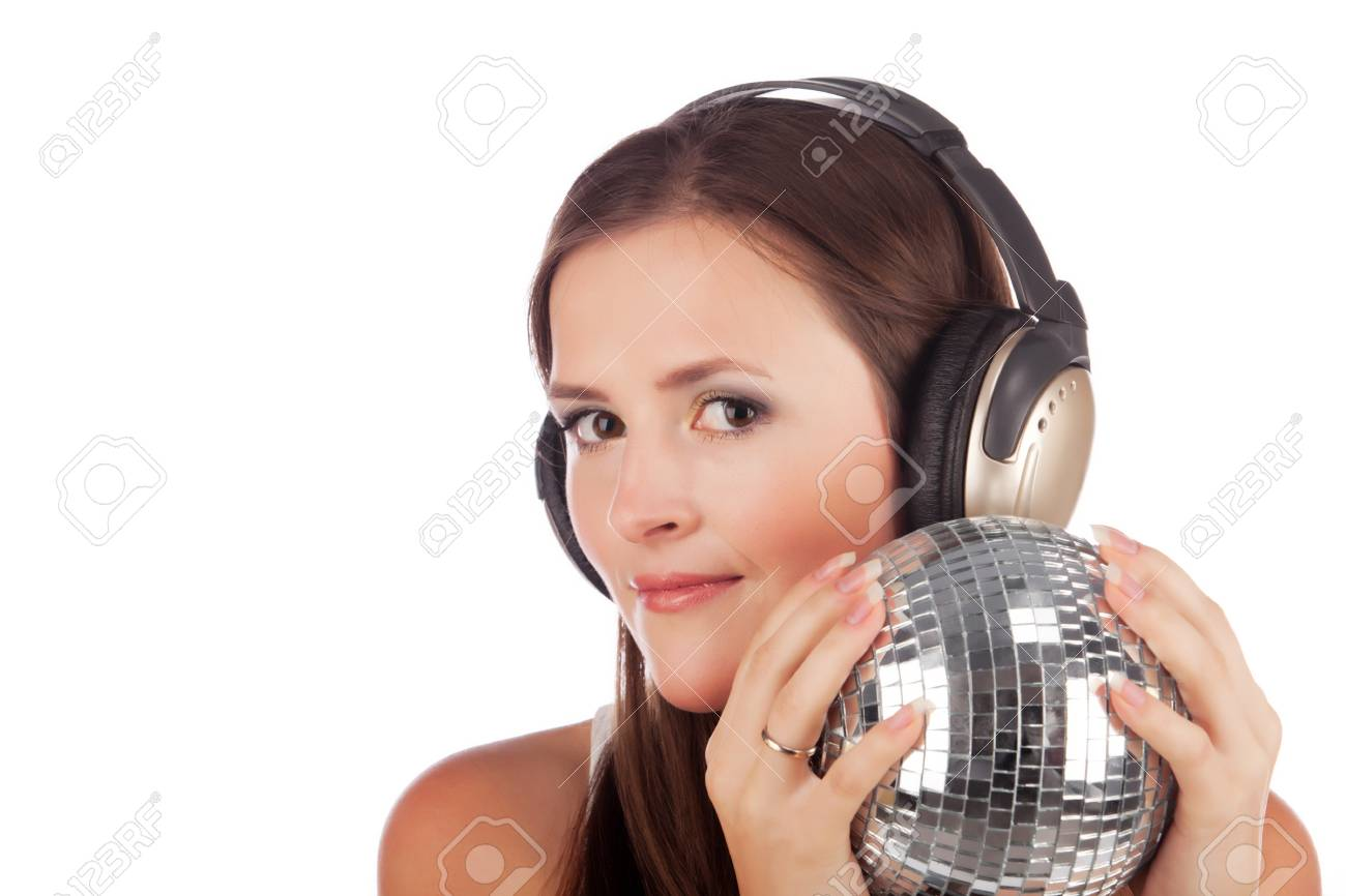 Girl in headphones and with a disco sphere in hands Stock Photo - 10300358