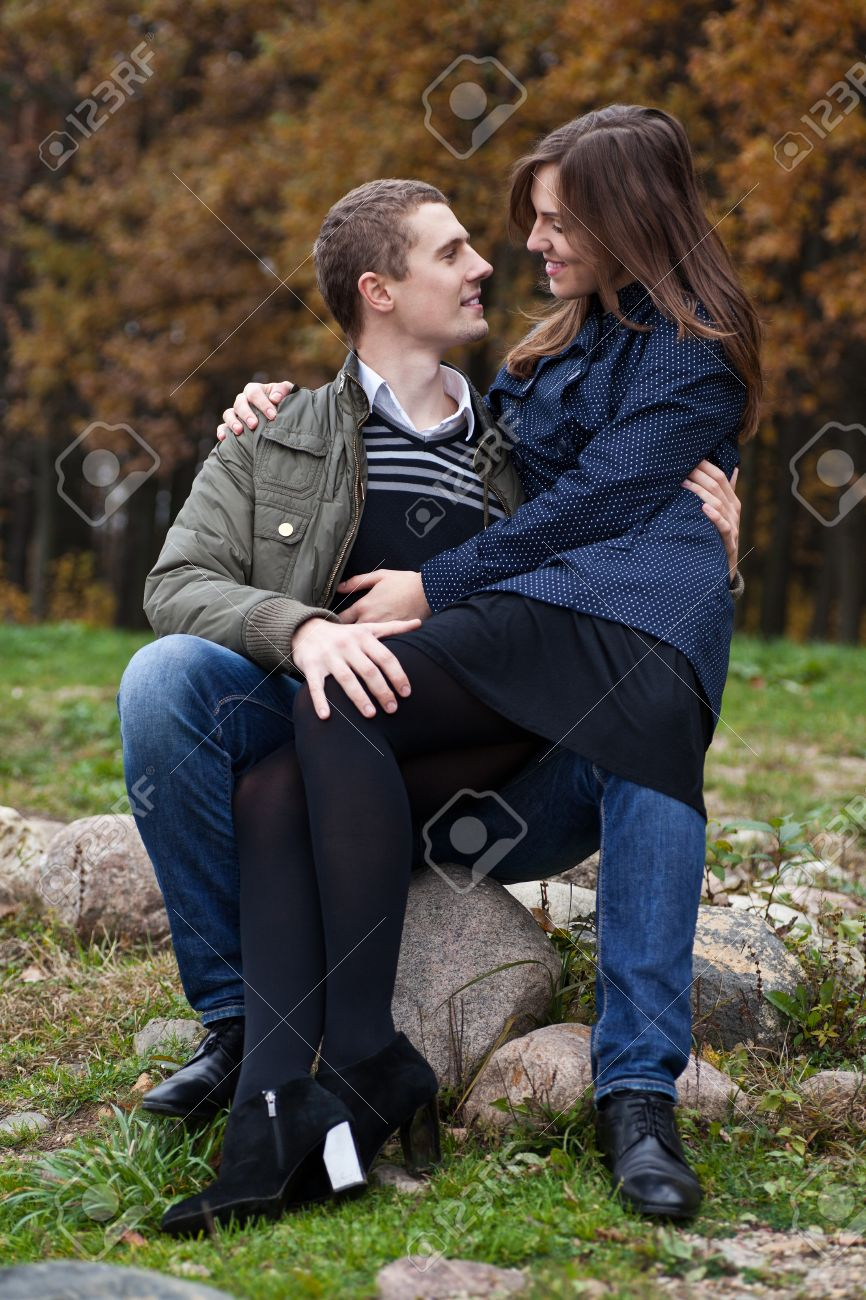 Young Couple In Autumn Park Girl Sitting On Lap Of Boyfriend Stock Photo Picture And Royalty Free Image Image 16115883