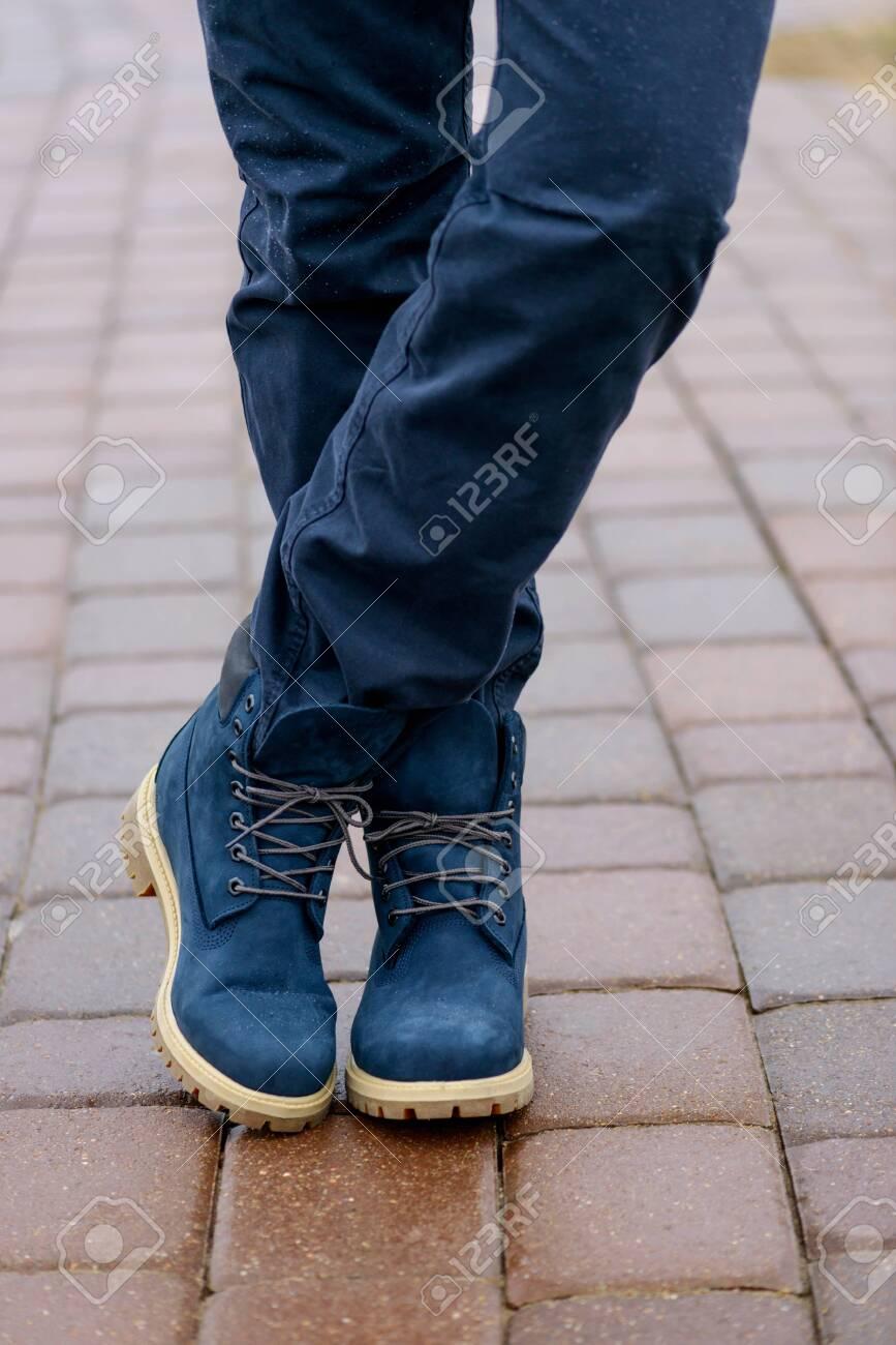 Blue Boots On Men's Legs In Blue Jeans