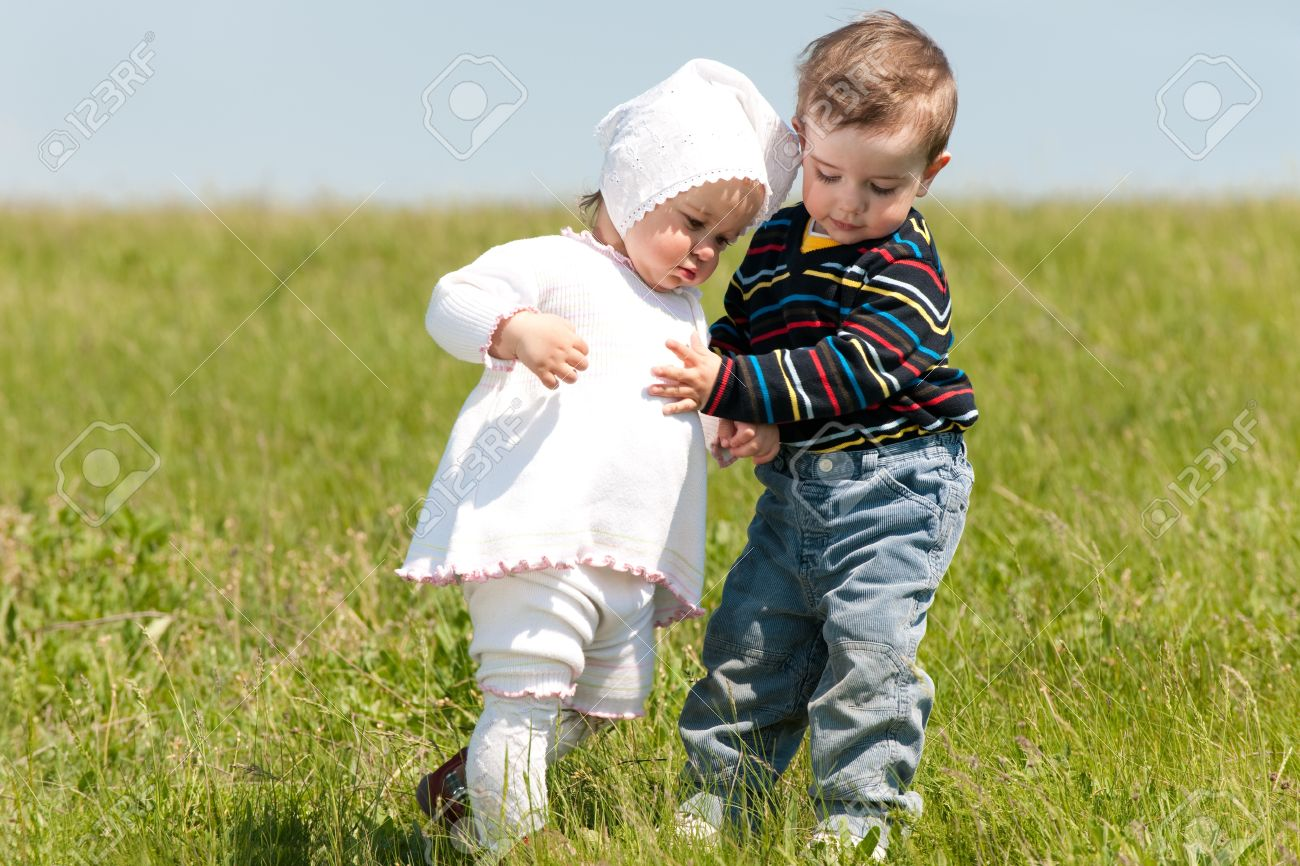 Two toddlers are walking on the meadow Stock Photo - 6947929