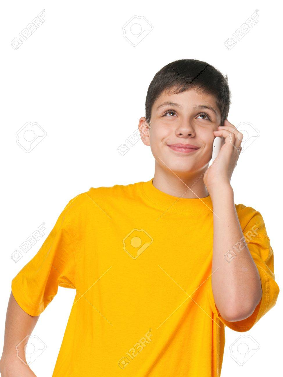 A portrait of a boy in yellow shirt with a cell phone; isolated on the white background Stock Photo - 11266556