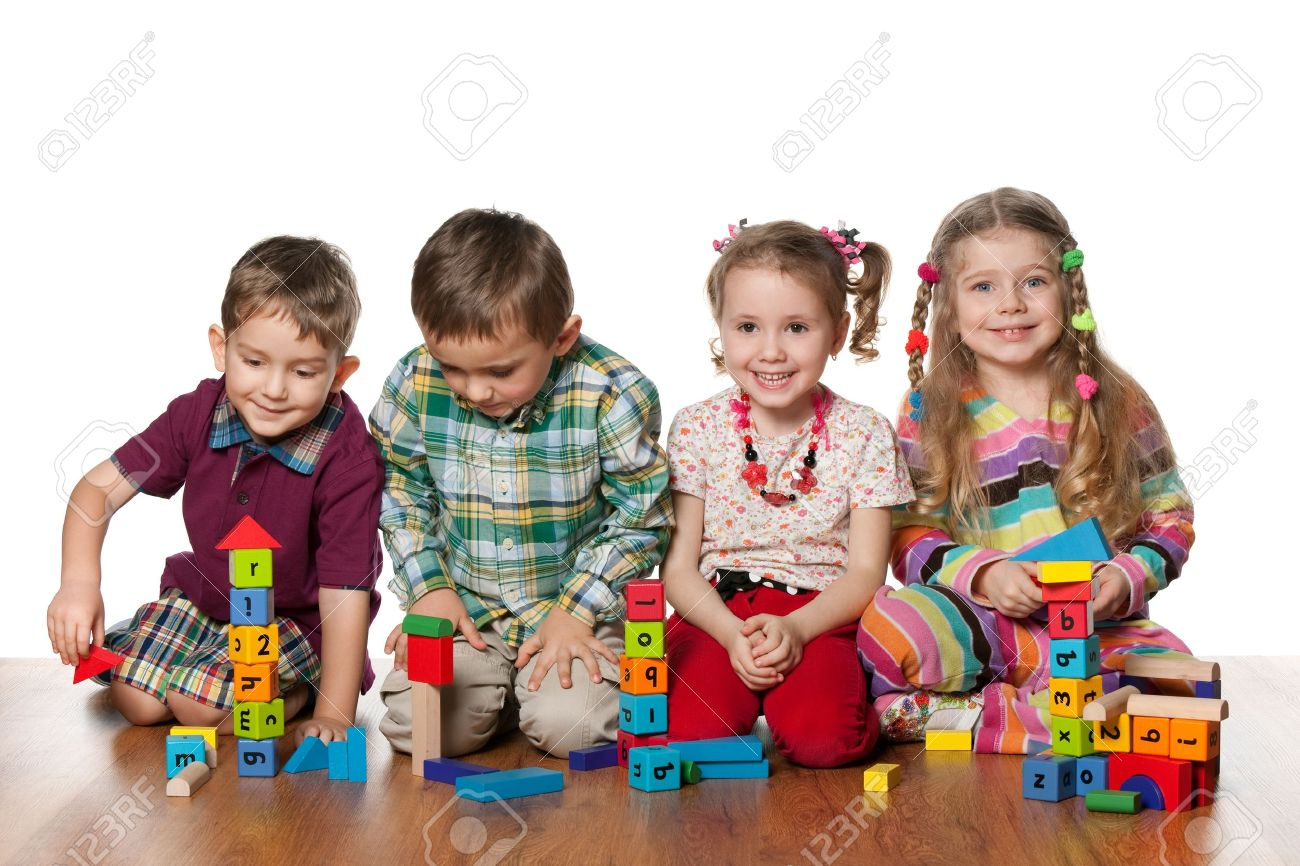 Four children are playing on the floor together; isolated on the white background Stock Photo - 12851581