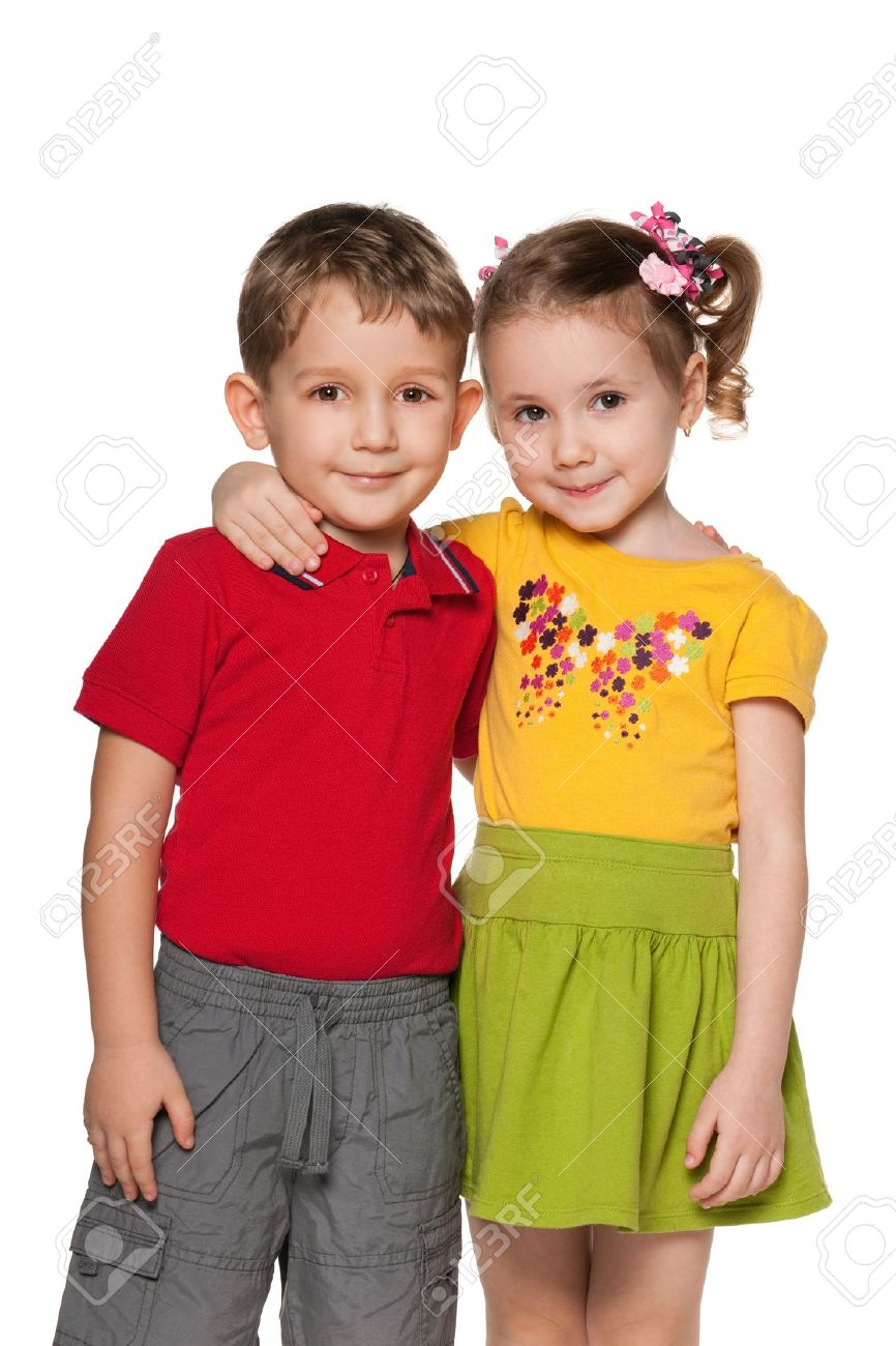 A boy and a girl are standing together; isolated on the white background Stock Photo - 12851838