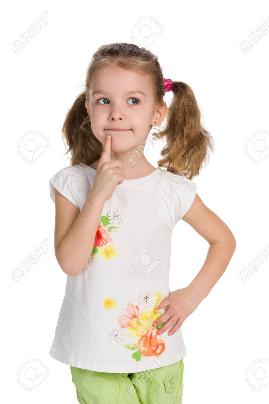 A curious little girl stands against the white background and thinks - 51613576