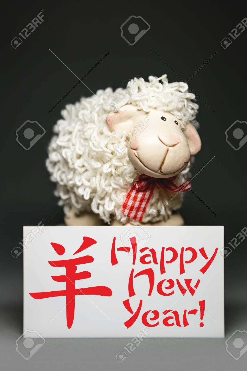 New year greeting card with white sheep toy the chinese symbol new year greeting card with white sheep toy the chinese symbol of 2015 year on gray kristyandbryce Image collections