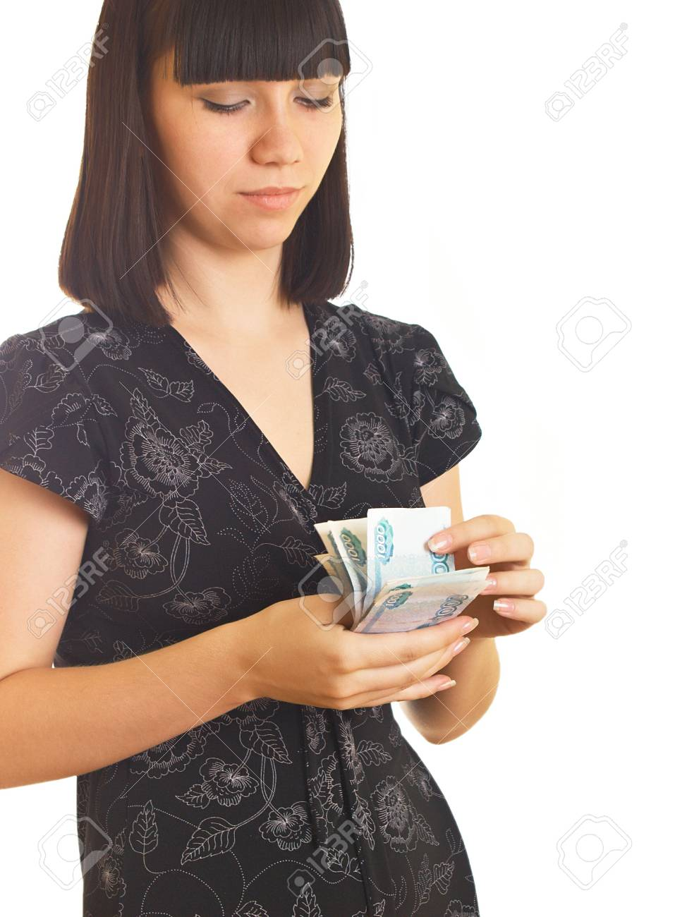 The young girl holds in hands Russian money for a white background Stock Photo - 5177806