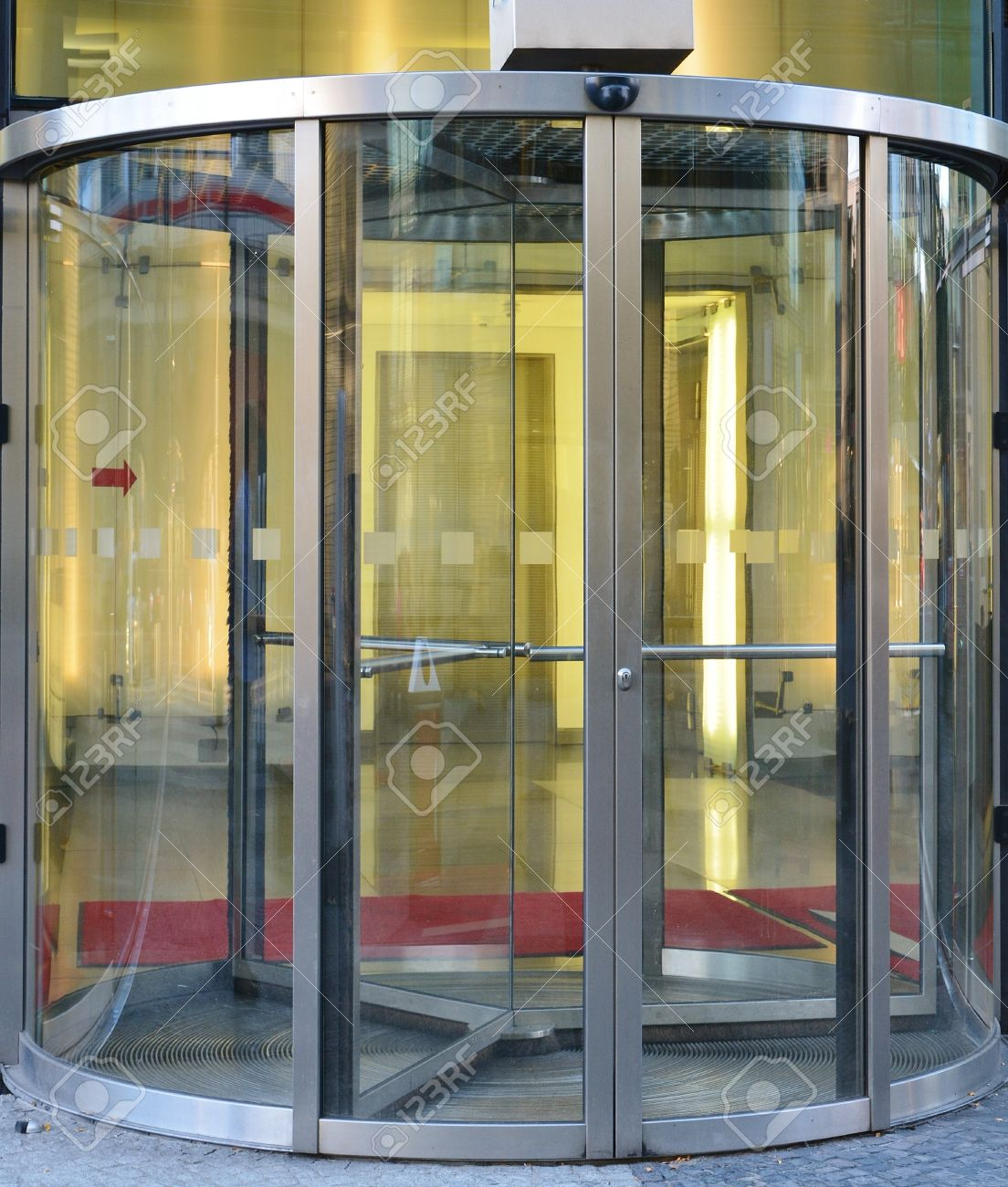 Modern revolving door as entrance to office building or hotel Stock Photo & Rotating Door Stock Photos. Royalty Free Business Images