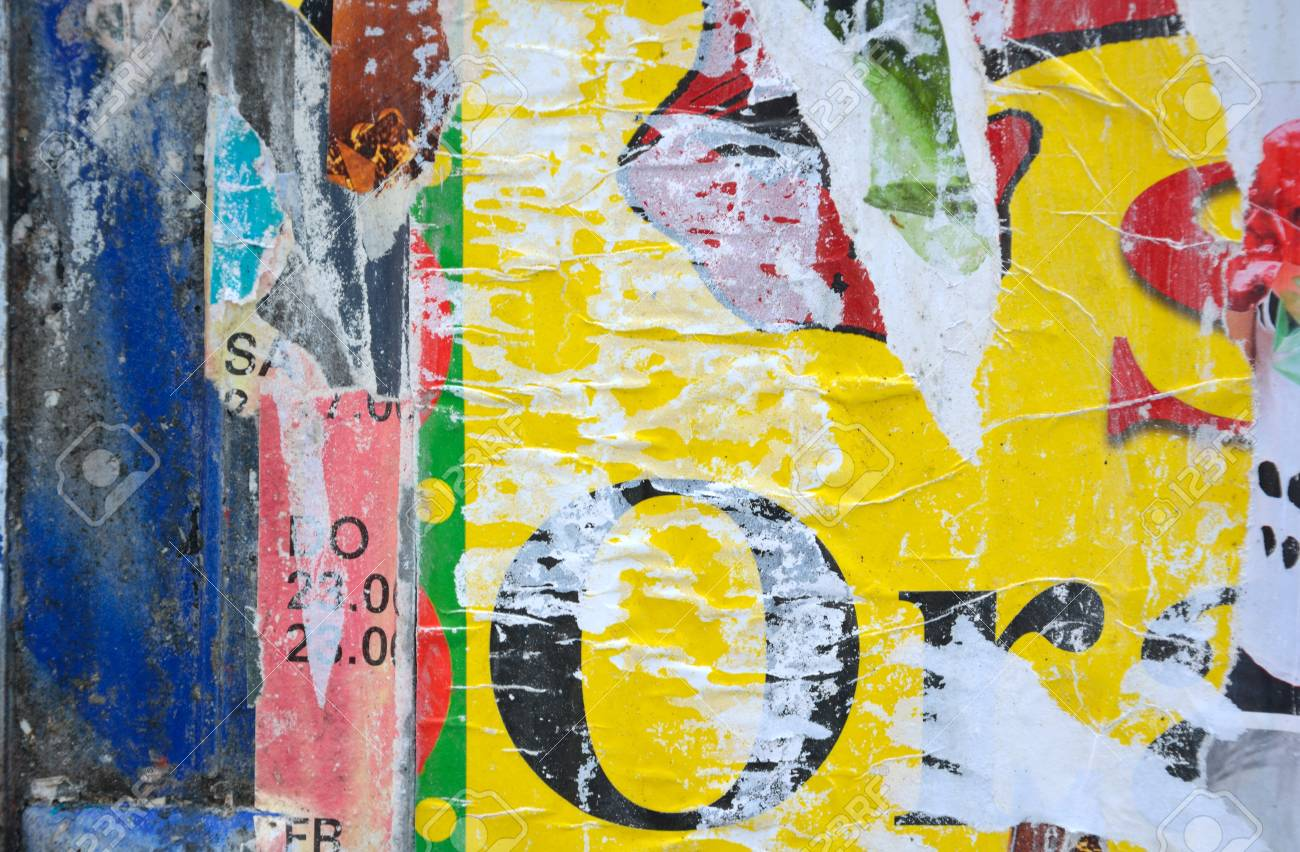 Colorful Torn Posters On Grunge Old Walls As Creative And Abstract ...