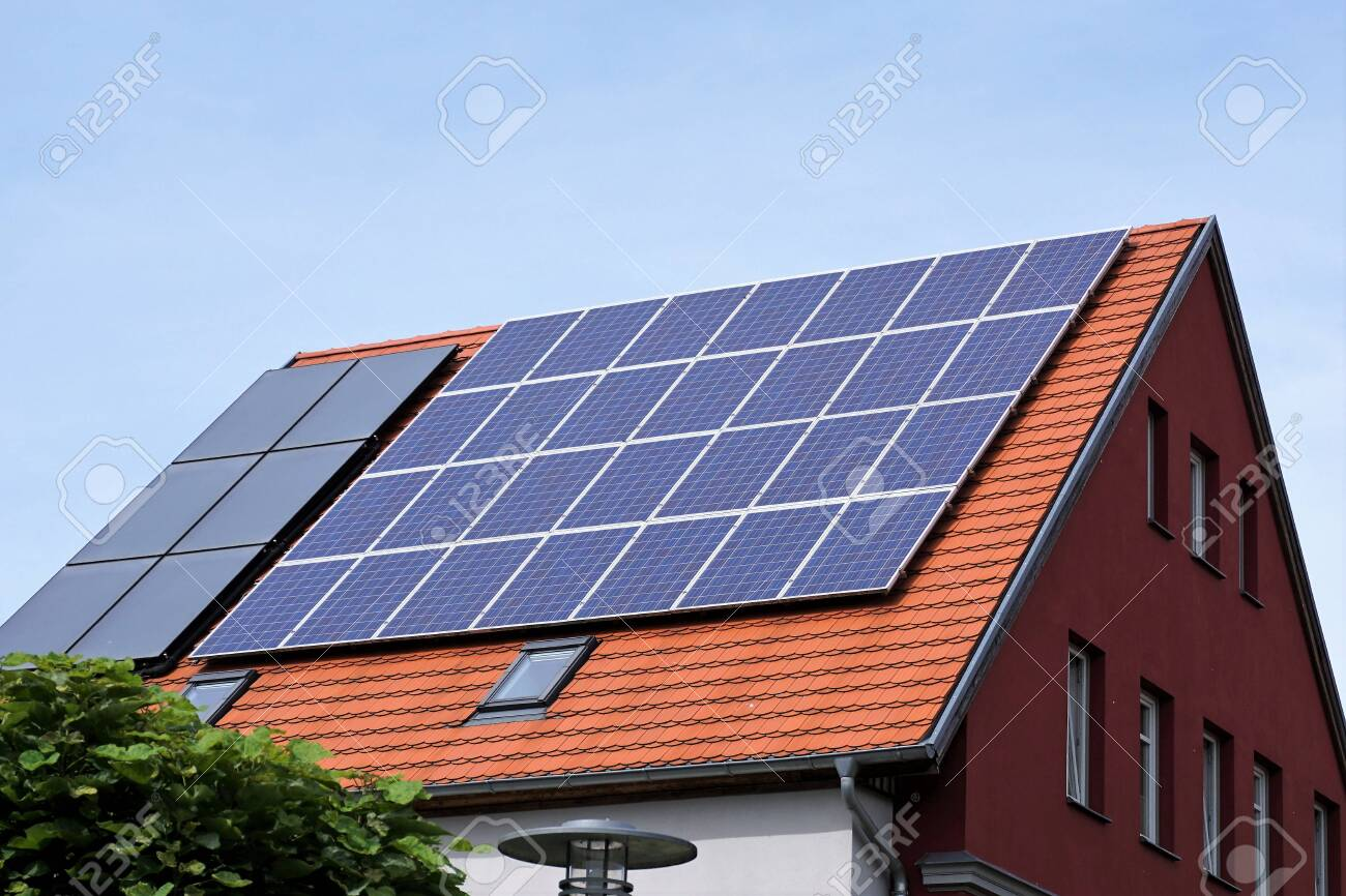 Ecological and renewable solar energy panels on the roof of a house - 132070658