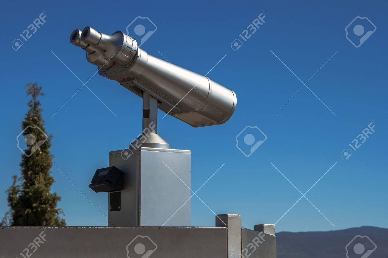 Stationary Viewing Binoculars On The Site Is On A Background Stock